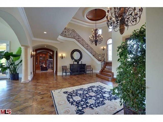 Kim Kardashian decor style New Year's Eve and Kim Kardashian decor Style foyer includes black walnut parque floors large chandeliers